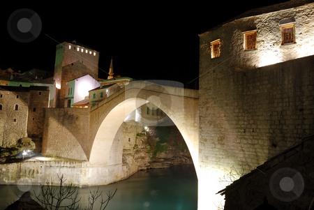 Mostar Old Bridge With Towers at Night stock photo, Old Bridge in Mostar at night reconstructed in 2003 after the original from 1556. by Denis Radovanovic