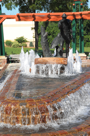 Fountain stock photo, A nice fountain in the city with an bronze statue on. by Horst Petzold