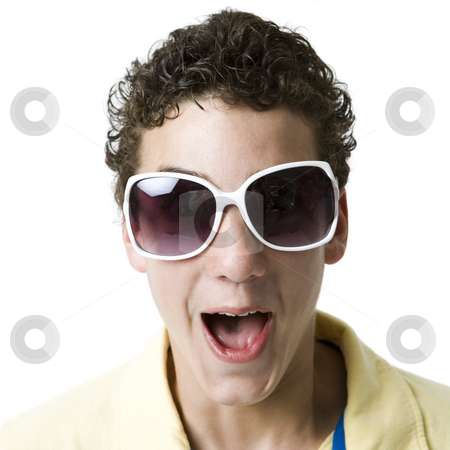 Kid with funky glasses stock photo, A boy with funky white sunglasses screams by Rick Becker-Leckrone