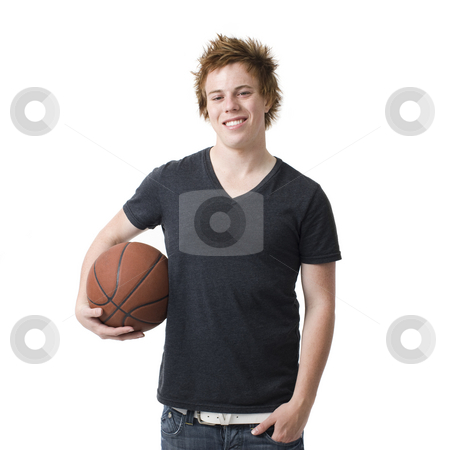 Boy with basketball stock photo, A boy with a basketball smiles by Rick Becker-Leckrone