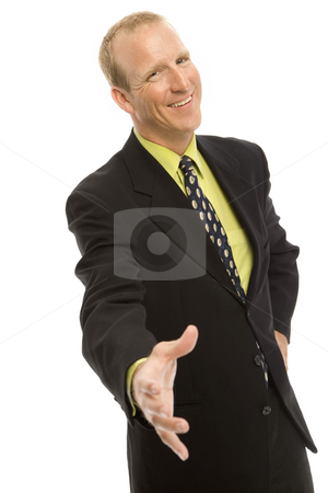 Businessman gestures a handshake stock photo, Businessman holds out his hand for a handshake by Rick Becker-Leckrone
