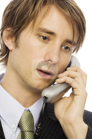 Businessman talks on phone stock photo, Businessman in a suit uses a corded telephone by Rick Becker-Leckrone