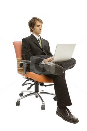 Businessman in seat with laptop stock photo, Businessman sits in a seat and uses a laptop by Rick Becker-Leckrone