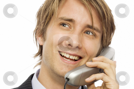 Businessman uses phone stock photo, Businessman in a suit uses a corded telephone by Rick Becker-Leckrone