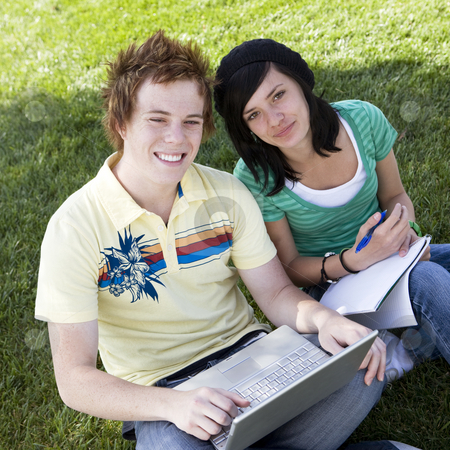 Teen couple do homework stock photo, Teen couple do homework in park by Rick Becker-Leckrone