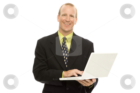 Businessman with laptop stock photo, Businessman in a suit holds a laptop and smiles by Rick Becker-Leckrone