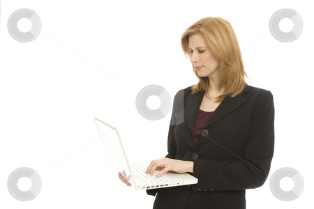 Businesswoman with laptop stock photo, A businesswoman in a suit holds up a laptop by Rick Becker-Leckrone