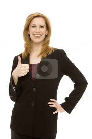 Businesswoman gestures thumbs-up stock photo, A busineswoman gestures a thumbs-up by Rick Becker-Leckrone