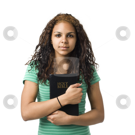 Girl holds bible stock photo, Teen girl holds bible in her hands by Rick Becker-Leckrone
