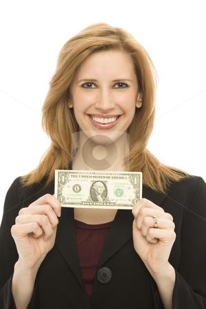 Businesswoman hold dollar bill stock photo, Businesswoman in a suit holds a dollar bill by Rick Becker-Leckrone