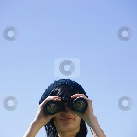 Teen with binoculars stock photo, A teenager looks through binoculars by Rick Becker-Leckrone
