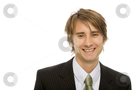Businessman in suit stock photo, Businessman in a black suit and a green tie smiles by Rick Becker-Leckrone