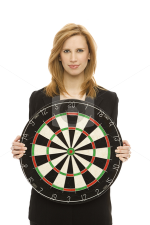 Businesswoman with dart board stock photo, Businesswoman in a suit holds a dart board by Rick Becker-Leckrone