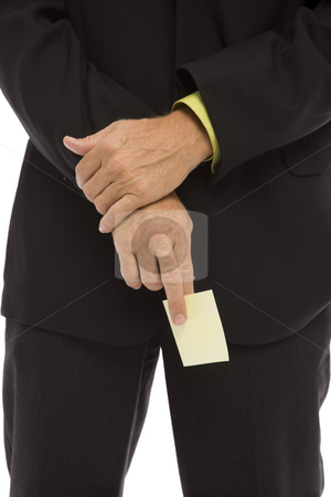 Businessman holds a note stock photo, Businessman holds a yellow square note by Rick Becker-Leckrone