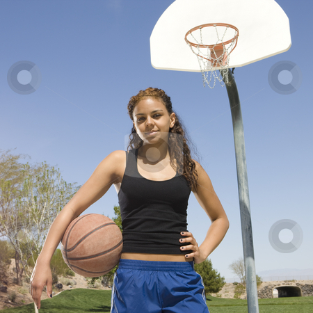 Teen girl with basketball stock photo, Teen girl with basketball hangs out at the park by Rick Becker-Leckrone