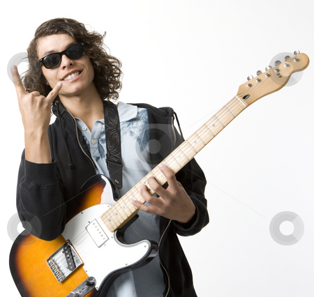Boy with guitar gestures stock photo, A boy with an electric guitar smiles and gestures by Rick Becker-Leckrone