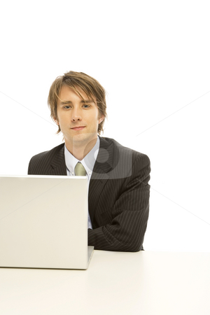 Businessman with laptop stock photo, Businessman uses a laptop and smiles by Rick Becker-Leckrone