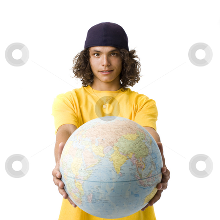 Boy holds out globe stock photo, A boy with a cap holds out a globe by Rick Becker-Leckrone