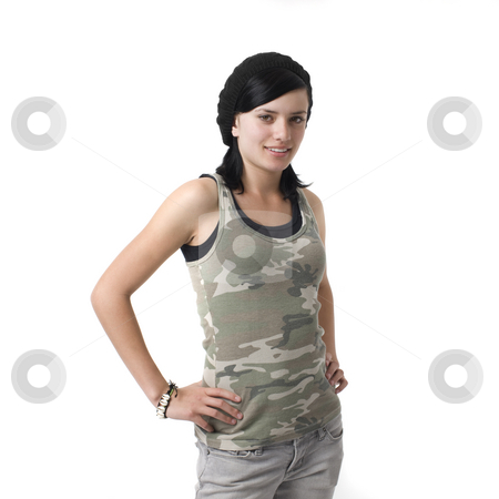 Girl in studio stock photo, A girl in an army shirt smiles by Rick Becker-Leckrone