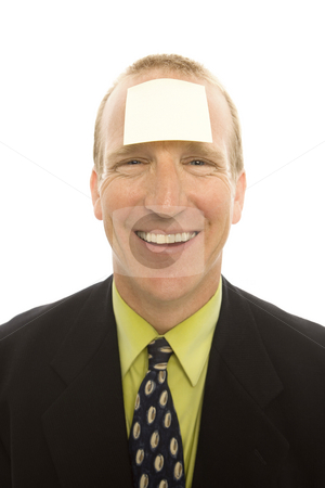 Businessman with note stock photo, Businessman in a suit smiles with a note stuck to his head by Rick Becker-Leckrone