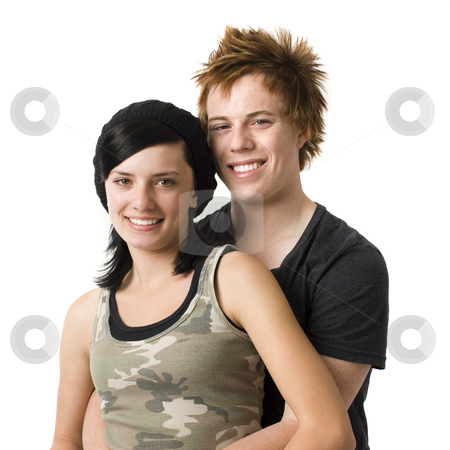 Teen couple stock photo, Happy teen couple in studio by Rick Becker-Leckrone