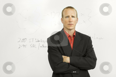 Businessman with writing board stock photo, Businessman stands in front of writing board by Rick Becker-Leckrone