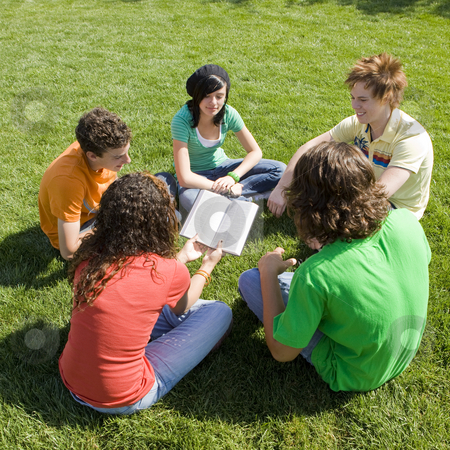 Five teens with bible stock photo, Five teens hang out in a park and share a bible by Rick Becker-Leckrone