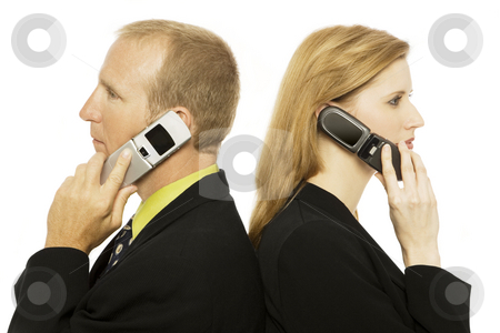 Business people with cell phones stock photo, Two business people use cell phones by Rick Becker-Leckrone