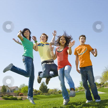 Happy teens jump stock photo, Four happy teens jump in air by Rick Becker-Leckrone