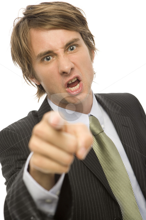 Businessman points in anger stock photo, Businessman in a suit points with his finger in anger by Rick Becker-Leckrone