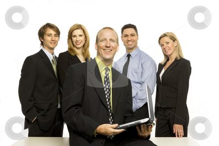 Business people near desk stock photo, Five business people stand proudly near a desk by Rick Becker-Leckrone