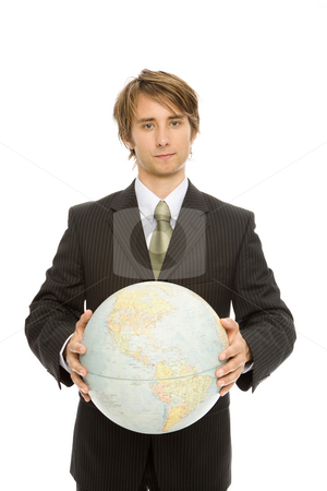 Businessman with globe stock photo, Businessman in a suit holds up a globe by Rick Becker-Leckrone