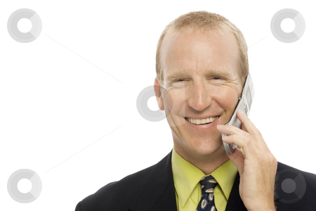 Businessman uses cell phone stock photo, Businessman in suit smiles and uses a cellular phone by Rick Becker-Leckrone