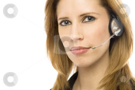 Businesswoman with headset stock photo, Businesswoman in a suit uses a modern headset by Rick Becker-Leckrone