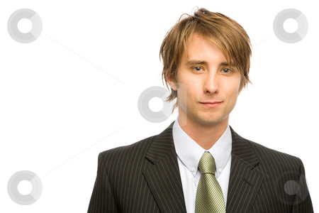 Young Businessman stock photo, A young businessman in a pinstripe suit and a green tie against a white background. by Rick Becker-Leckrone