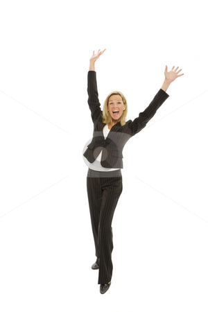 Businesswoman expresses triumph stock photo, Businesswoman in a suit raises her arms in triumph by Rick Becker-Leckrone