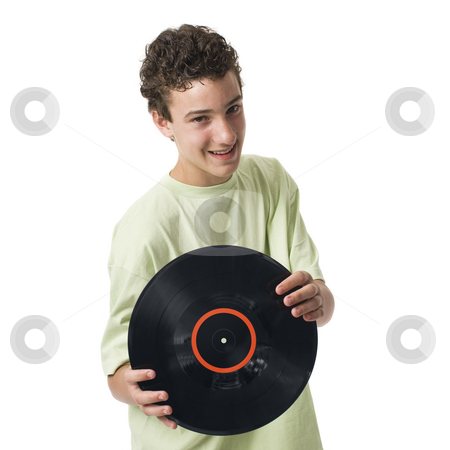Boy with record stock photo, A bot with a record smiles by Rick Becker-Leckrone