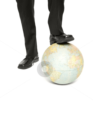 Businessman with globe stock photo, A business man rests is foot on a globe by Rick Becker-Leckrone