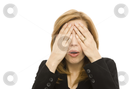 Businesswoman covers eyes stock photo, Businesswoman covers her eyes with her hands by Rick Becker-Leckrone