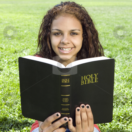 Teen with bible in park stock photo, A teenage girl hangs out in a park and studies her bible by Rick Becker-Leckrone