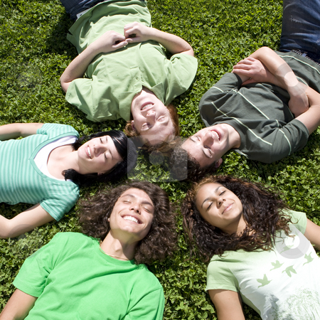Five teens in grass stock photo, Five teens lie in circle in the grass by Rick Becker-Leckrone
