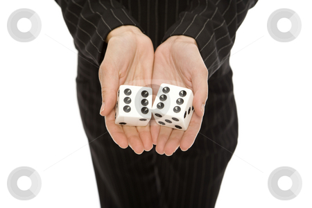 Woman in pinstripe suit with dice stock photo, Woman in a pinstripe suit holds a large pair of dice by Rick Becker-Leckrone