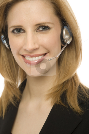 Businesswoman with headset stock photo, Businesswoman in suit happily uses a headset by Rick Becker-Leckrone