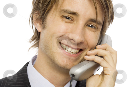 Businessman with telephone stock photo, Businessman in a suit uses a corded telephone by Rick Becker-Leckrone