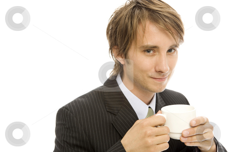 Businessman with coffee stock photo, Businessman holds a cup of coffee and smiles by Rick Becker-Leckrone