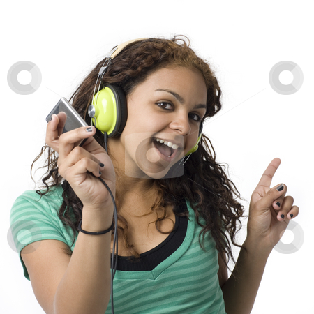 Girl with headphones stock photo, A girl sings along with her headphones and media player by Rick Becker-Leckrone