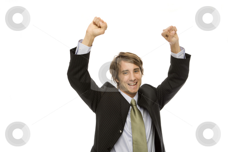 Businessman gestures success stock photo, Businessman in a suite raises his arms with triumph by Rick Becker-Leckrone