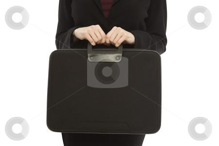 Businesswoman with black briefcase stock photo, Businesswoman in a suit holds a black briefcase by Rick Becker-Leckrone