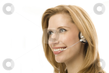Businesswoman uses a headset stock photo, Businesswoman in suit happily uses a headset by Rick Becker-Leckrone