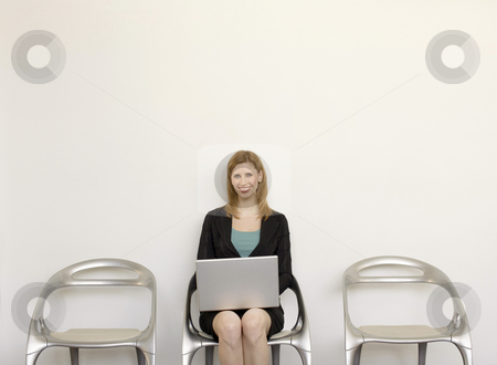 Businesswoman sits with laptop stock photo, Businesswoman sits in a chair and uses her laptop by Rick Becker-Leckrone